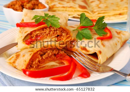 pancakes stuffed with minced meat and vegetables in bolognese sauce