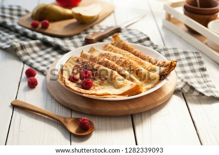 Pancakes Thin homemade pancakes with berries, traditional Russian cuisine. Homemade pancakes with berries Stockfoto ©