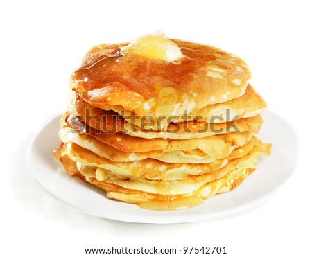 pancakes topped with honey