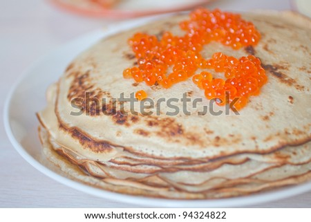 Pancakes with caviar traditionally served for shrovetide.