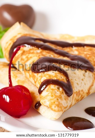pancakes with chocolate and cherries - stock photo