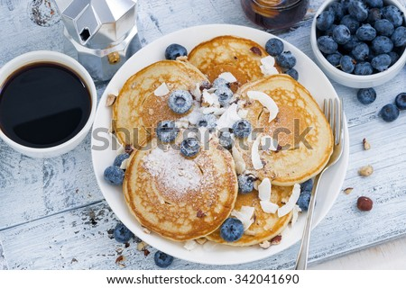 pancakes with fresh blueberries and honey for breakfast, top view, horizontal