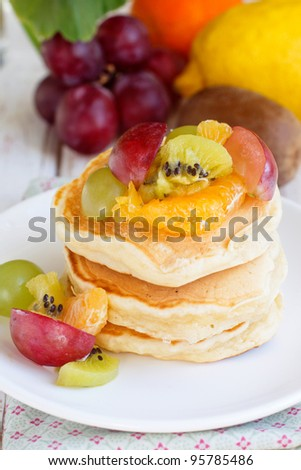 Pancakes with fruit salad - stock photo
