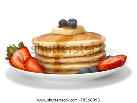 pancakes with fruits, butter and syrup isolated over white background
