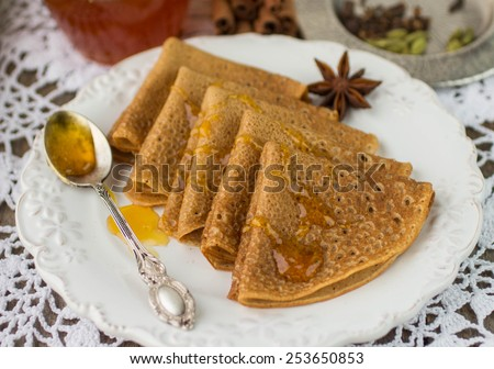 Pancakes with honey is a traditional Russian dish