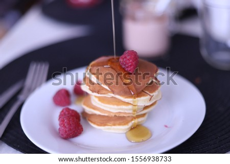 Pancakes with Maple Syrup and raspberries #1556938733