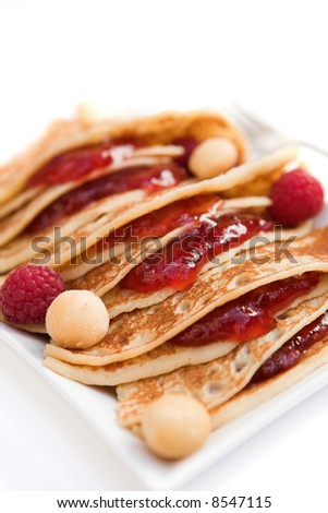 Pancakes with raspberry jam, fresh raspberries & Macadamia nuts - shallow dof