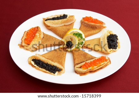 external image stock-photo-pancakes-with-red-and-black-roe-russian-national-food-15718399.jpg