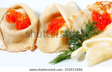 Pancakes with red caviar. A traditional Russian dish