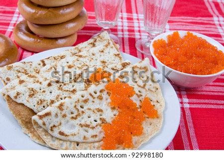 Pancakes with red caviar.The celebration of Maslenitsa - Russian religious and folk holiday.