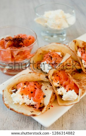 Pancakes with smoked salmon and curd cheese at Shrovetide