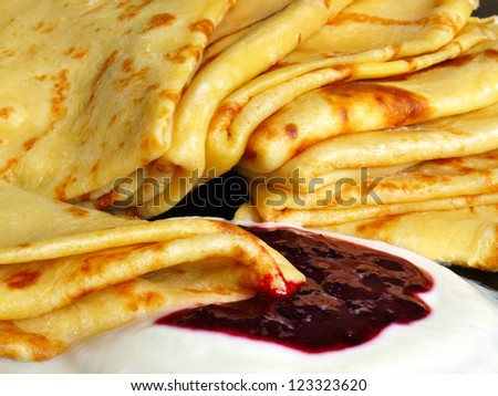 Pancakes with sour cream and raspberry jam