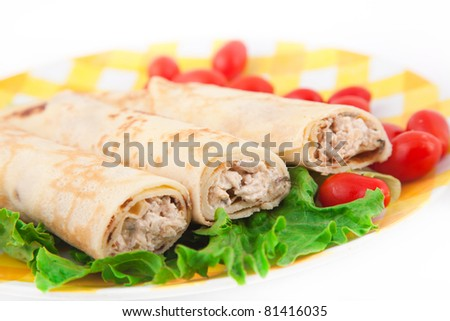 Pancakes with the chicken, lettuce, and tomatoes on the yellow plate