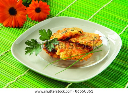 Pancakes with vegetables - zucchini, potatoes, carrots, onion and parsley