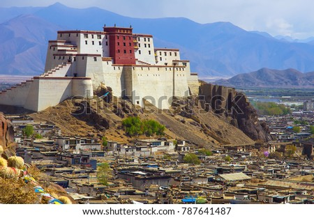Panchen Lama residency called Little Potala in Shigatse city, Tibet, China. Cityscape from old buddhist monastery.