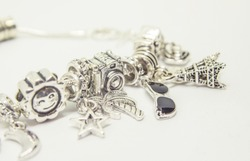 Pandora bracelet charms travel. Selective focus.