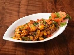 Paneer majestic, is a famous indian dish, served over a rustic wooden background, selective focus