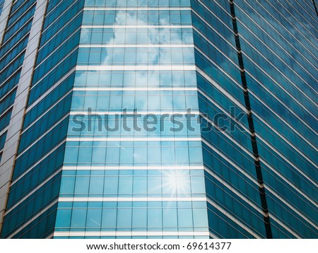 Panel glass windows of modern buildings and sky reflect