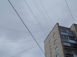 Panel house from the Soviet Union with a lot of badly located electrical wires. Socialist-era housing.
