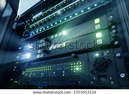 Panel modern servers in the data center. Supercomuter telecommunication technology. Server rack fuses #1355053526