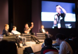 Panel on Stage during Discussion Event. Debate with Experts during Conference Seminar Presentation. Successful Executives and Entrepreneur Speakers and Presenters in Conference Hall Lecture Series.