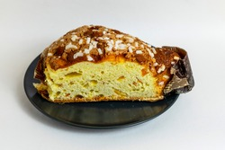 Panettone, Italian Christmas bread, with a brioche-like dough infused with a vanilla bean and studded with rum-soaked raisins and candied orange peel