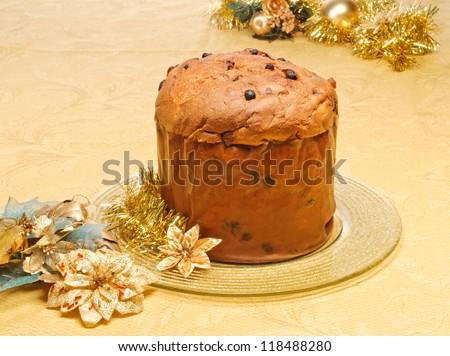 Panettone, typical Italian cake on golden dish
