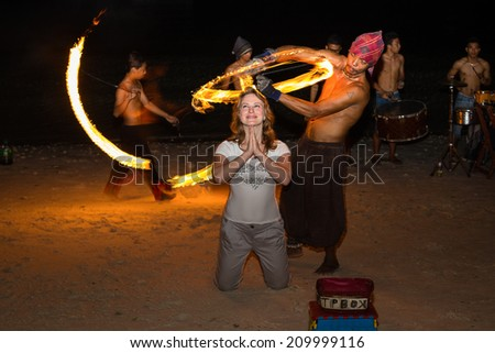 PANGLAO, PHILIPPINES - FEBRUARY 20, 2014 :Fire show festival at the beach. Unidentified man performing a dance with fire. Philippines is one of the top tourist destinations in the world.