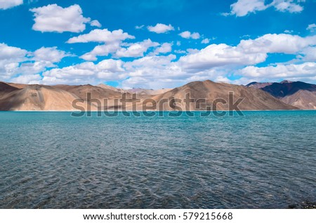 Pangong Tso an endorheic lake in the Himalayas at altitude of 4,350 m in Ladakh, Kashmir, North India. Pangong means high grassland lake in Tibetan . It is 134 km long and extends from India to China. #579215668