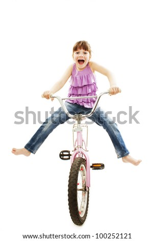 Panicked little girl losing control over her riding bike. Isolated on white background.