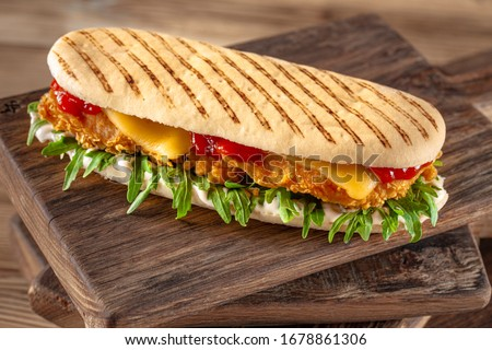 panini sandwich with crispy chicken and rucola salad Stok fotoğraf ©