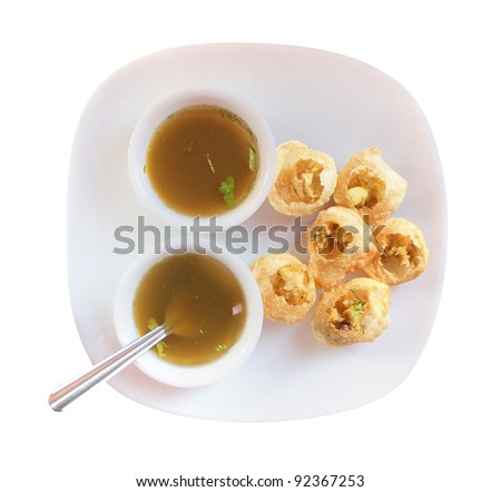Panipuri snack also called gol gappa or phuchka - a famous indian delicacy isolated on white