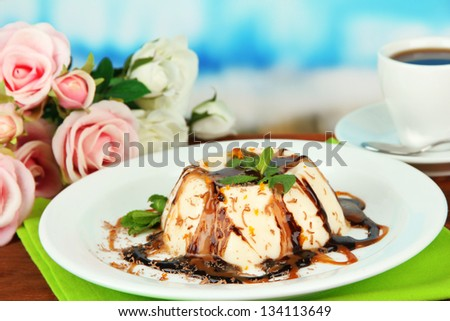 Panna Cotta with chocolate  and caramel sauces, on bright background