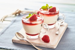 Panna cotta with rasperry and mint  topping with strawberry sauce