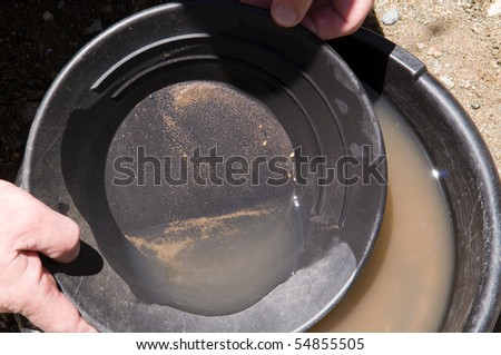 Panning for gold - a few flakes appear