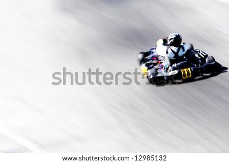 stock photo : Panning shot of a go-kart racer. Horizontal orientation.