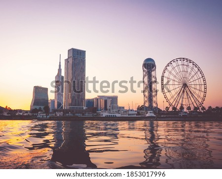 Panoamic View to Batumi coast and tourist attractions with romantic sunset in the bacground. Vacation holidays in caucasus. Georgian vegas.