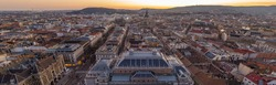 Panorama aerial drone shot of east facade of St. Stephen's Basilica in Budapest sunrise morning glow in winter