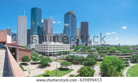 Panorama aerial view downtown Houston next to I-45 freeway during daytime, cloud blue sky. The most populous city in Texas and the fourth-most in United States. Transportation, architecture background #639890413