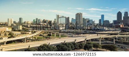 Panorama aerial view highway stack interchange and Dallas Downtown buildings under cloud blue sky. Woodall Rodgers Freeway, Stemmons Freeway, Interstate 35E (I-35E) #1266972115