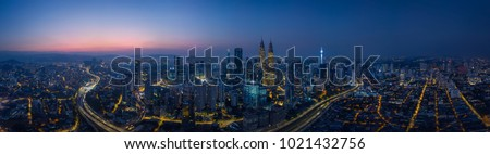 Panorama aerial view in the middle of Kuala Lumpur cityscape skyline .Night scene before sunrise , Malaysia . #1021432756