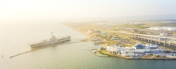 Panorama aerial view North Beach in Corpus Christi, Texas, USA with aircraft carrier ship