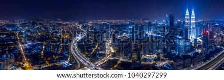 Panorama aerial view of Kuala Lumpur City center at night dusk.