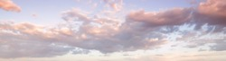 Panorama afternoon sky with clouds. Golden hours sky pattern background