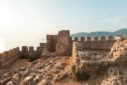 Panorama ancient Greco Roman city. Ruins of an ancient fortress, Alanya, Turkey. Ruined ancient military fort in Europe. Alanya is popular tourist destination in Turkey
