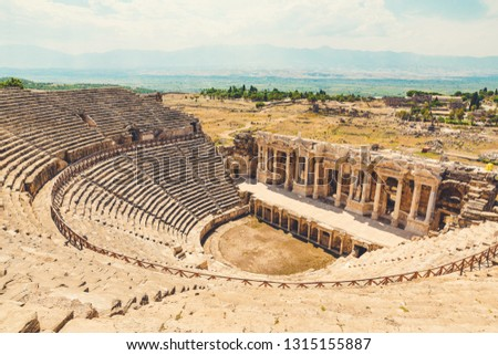 Panorama ancient Greco Roman city. Ruins of ancient city of old amphitheater, Hierapolis in Pamukkale, Turkey. Ruined ancient city in Europe. Is popular tourist destination in Turkey
