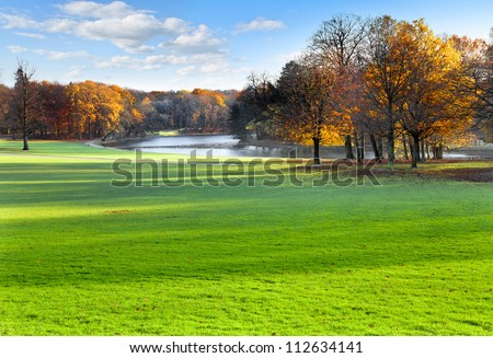 Panorama. Autumn Landscape. Park in Autumn. The bright colors of autumn in the park by the lake.