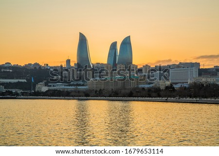 Panorama Baku city in he morning, Azerbaijan . Night view of Baku and the seaside of the Caspian sea. Sunset in Baku. Colorful sunset on the Baku boulevard . The seaside of the Caspian sea .