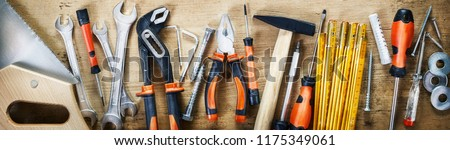 Panorama banner of assorted hand tools on wood for renovations, DIY, building and construction or woodworking #1175349061