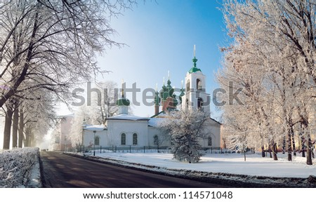 Panorama  beautiful church in Russia winter morning on embankment with white trees